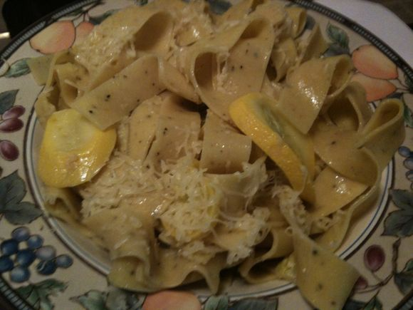 Lemon pepper farfalle with yellow squash and Romano cheese